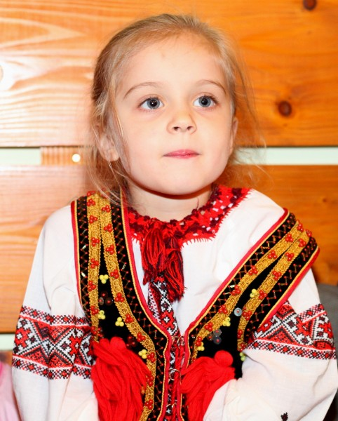 a cute charming beautiful Catholic child girl in a Church, photo 3
