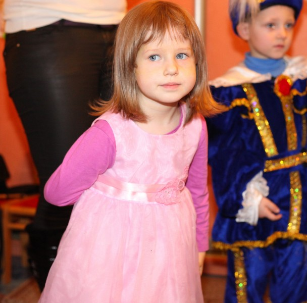 a beautiful fair-haired child girl in a Catholic kindergarten, photo 12