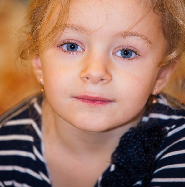 a cute child girl photographed in December 2013, picture 2/2
