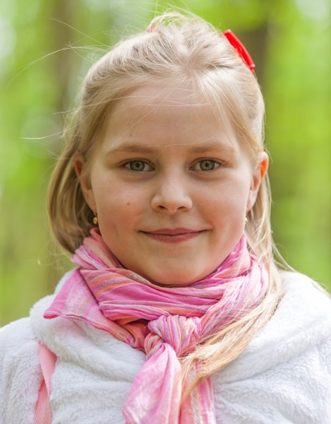 a cute Roman-Catholic blond child girl photographed in April 2014, portrait 11/29