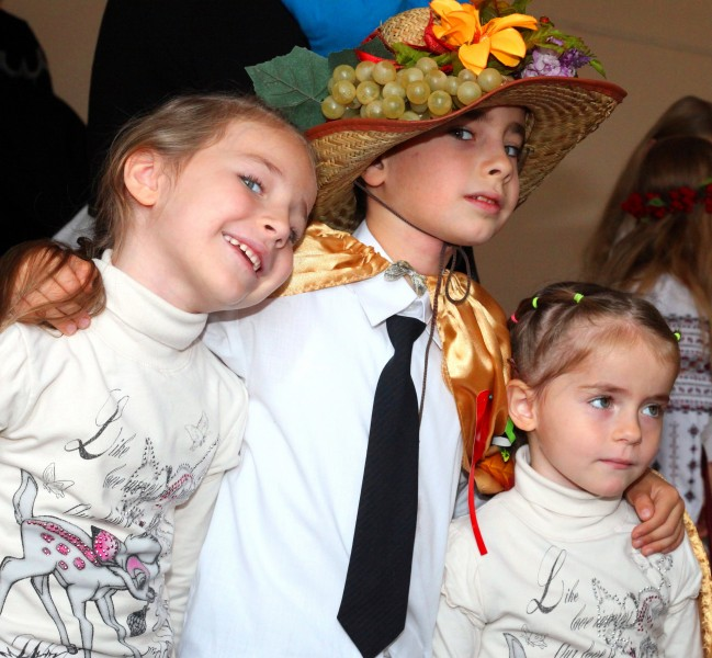 a muslim boy with his two charming sisters, photo 2