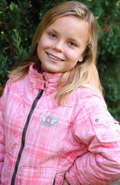 a young blond girl photographed in September 2013, picture 1/4