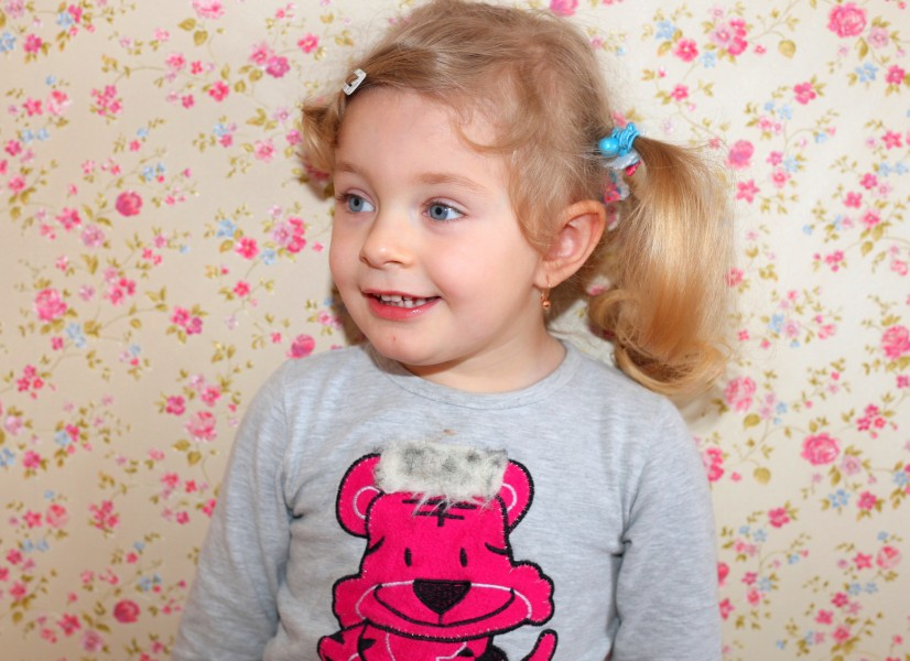 a cute blond child girl with beautiful eyes, photo 1