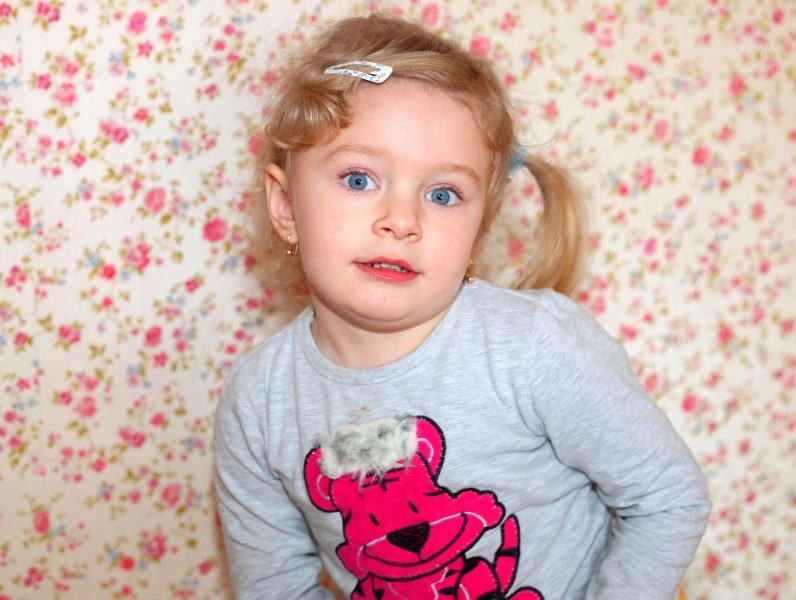 a cute blond child girl with beautiful eyes, photo 3