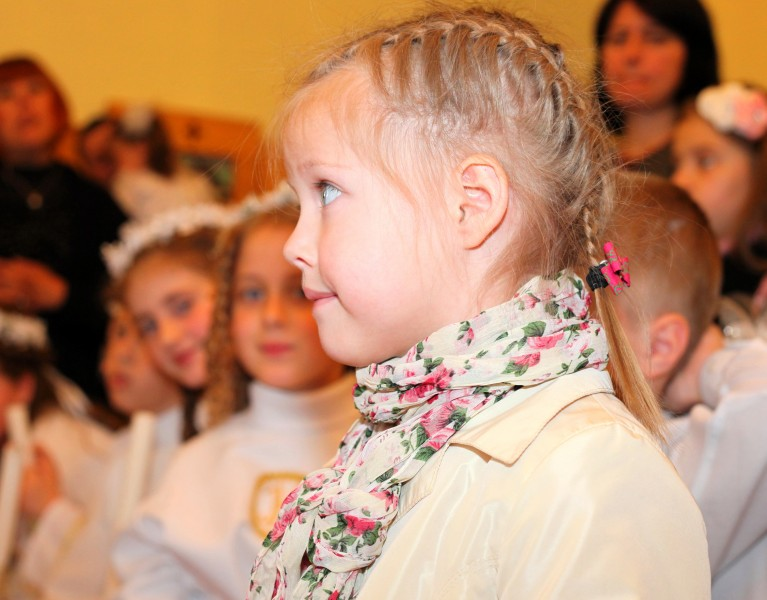 a cute blond child girl in a church in May 2013