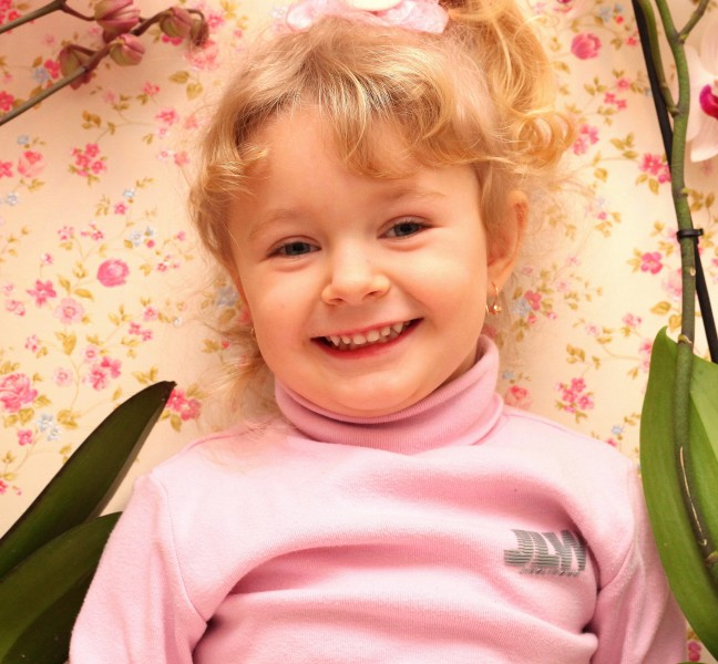 a young cute blond smiling baby girl, photo 1