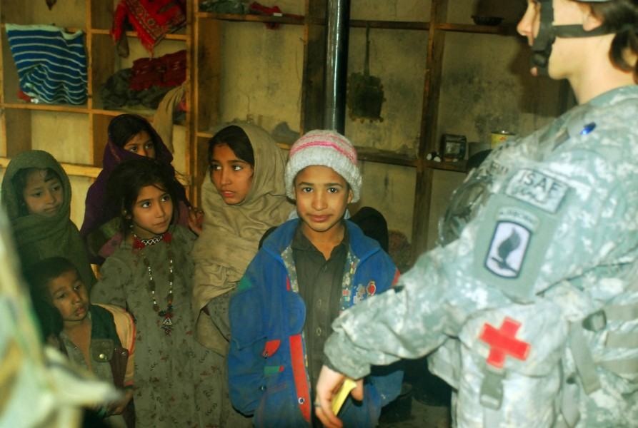 Afghan children line up to be seen by Army medic at Forward Operating Base Naray