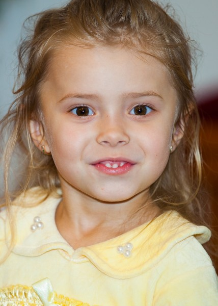 an amazing blond child girl in a Catholic kindergarten photographed in November 2013, picture 5