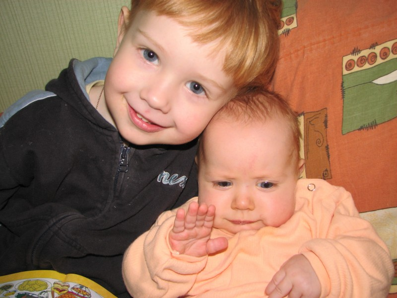 a boy with a funny baby girl (brother and sister)