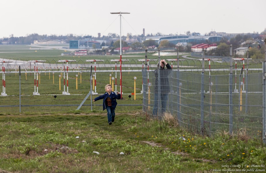 boys near an airport in April 2019 photographed by Serhiy Lvivsky