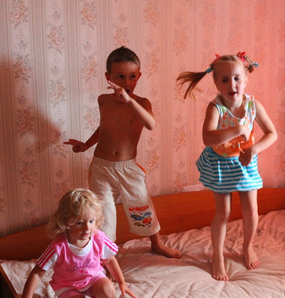 Children dancing on a bed, picture 2