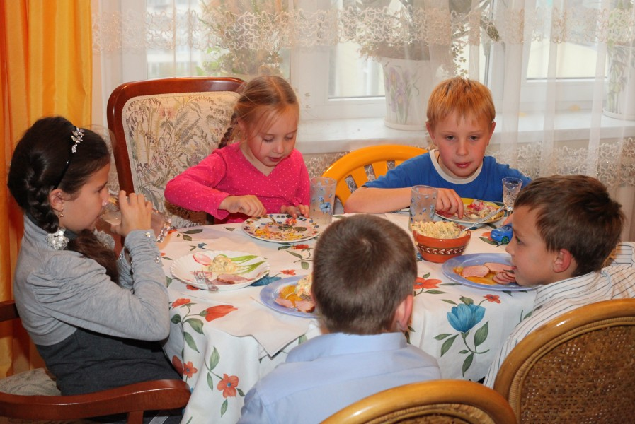 children having meal on a birthday party