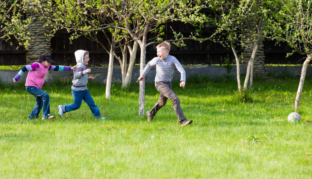 children running on the grass in May 2014