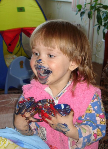 Girl eating paint