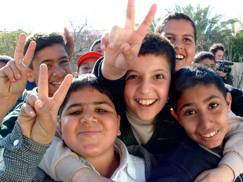 Iraqi boys giving peace sign