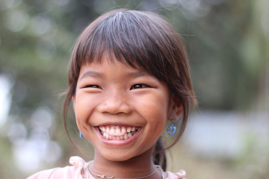 Lao little girl laughing with teeth