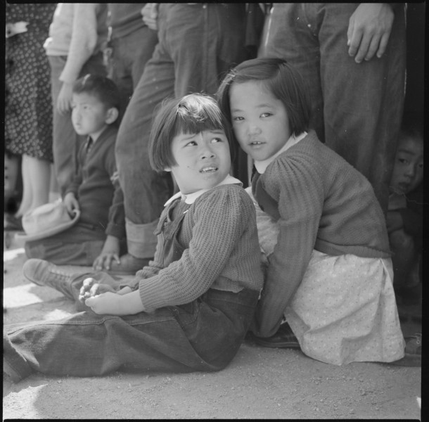 Manzanar Relocation Center, Manzanar, California. Little evacuees of Japanese descent watch Memoria . . . - NARA - 538542