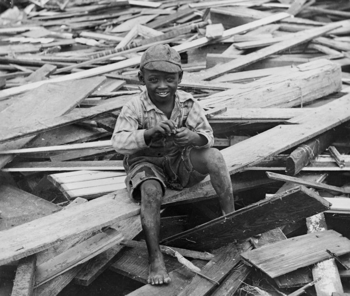 No Known Restrictions Young Boy Sits on Galveston Hurricane Debris by M.H. Zahner, 1900 (LOC) (493281477)