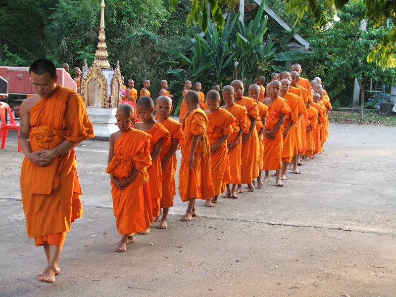 Novice in the Buddhist religion faculty is walking back and forth