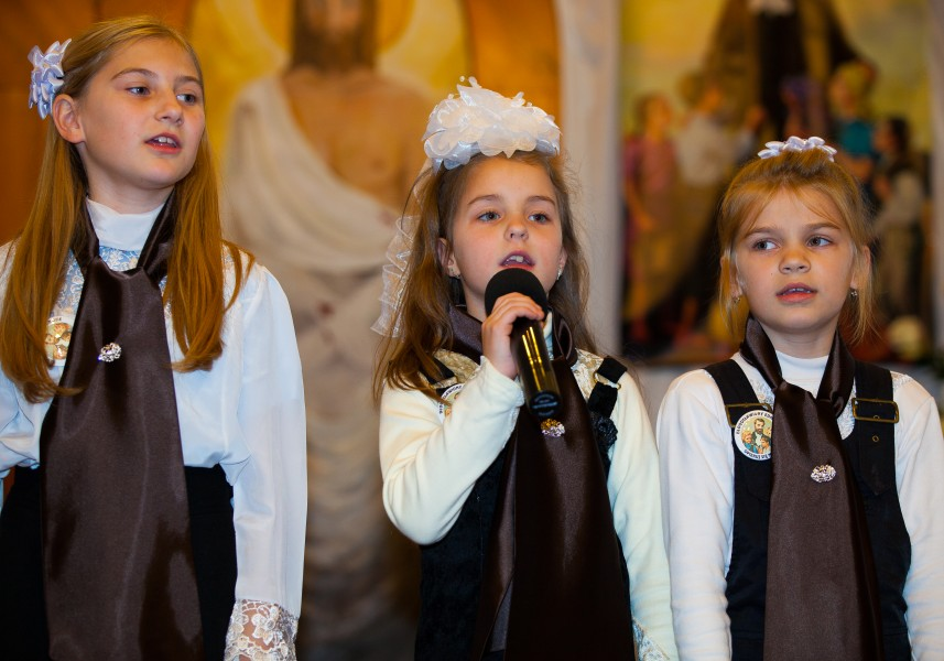 three young girls performing in a Catholic chapel in November 2013