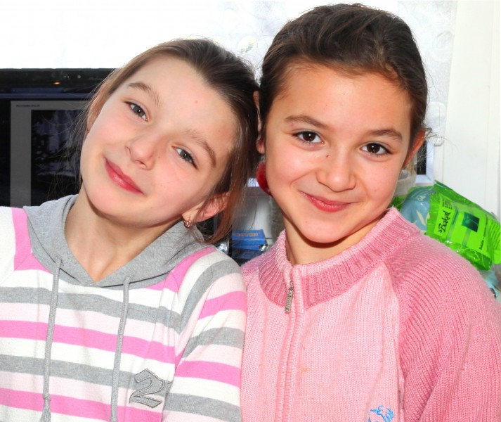 two cute brunette Catholic child girls in the Church's premises, photo 2