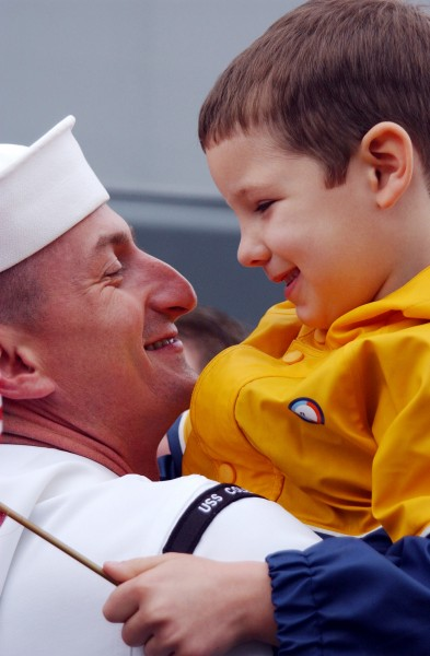 US Navy 020425-N-1110A-502 Sailor is greeted by son during homecoming