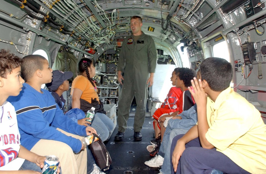 US Navy 040527-N-4936C-112 U.S. Marine Corps Sgt. George Watson, assigned to Marine Medium Helicopter Squadron Seven Seven Four (HMM-774), talks to children inside a CH-46E Sea Knight