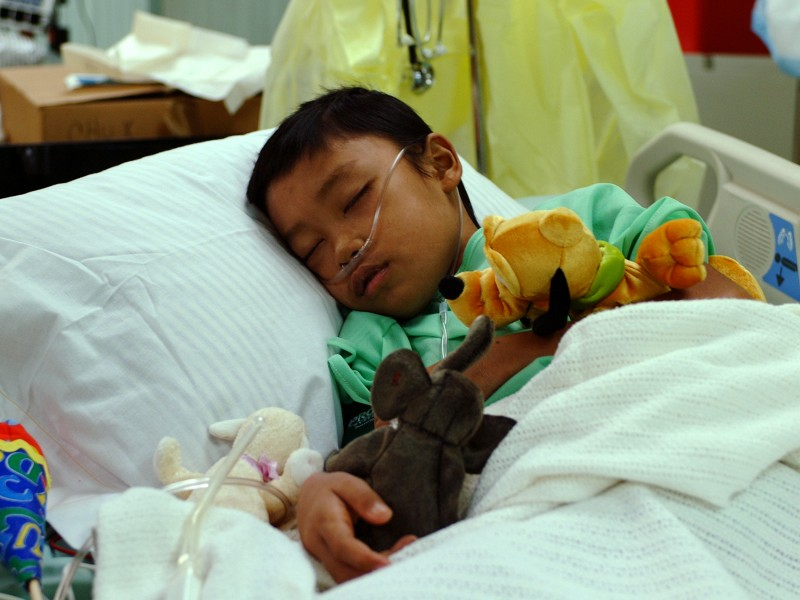 US Navy 050214-N-0357S-060 An 11-year old Indonesian boy rests in a hospital bed in the Intensive Care Unit aboard the Military Sealift Command (MSC) hospital ship USNS Mercy (T-AH 19)