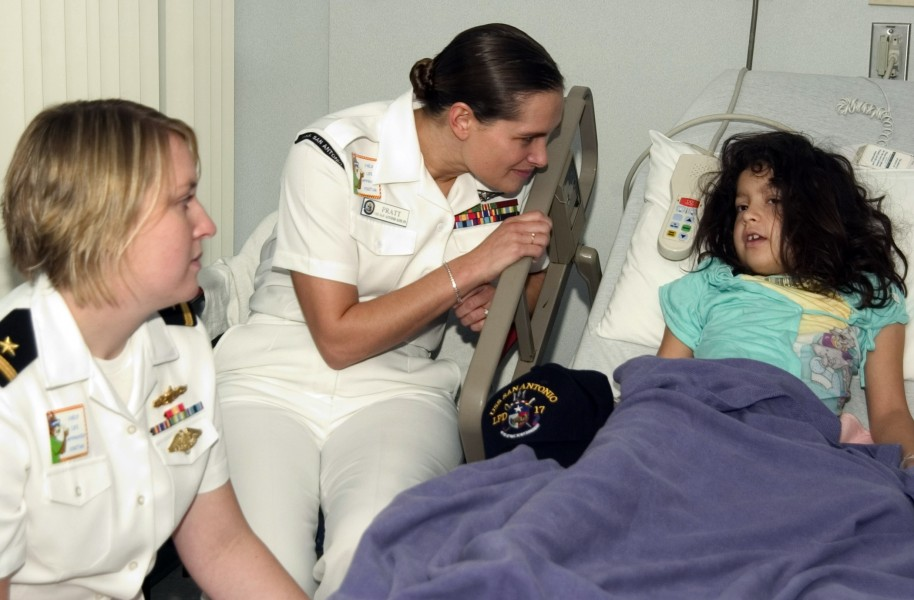 US Navy 061108-N-3750S-147 Six year-old girl talks about what she likes to do at home with Hospital Corpsman 2nd Class April Pratt and Ensign Ann Luken at the Methodist Children's Hospital