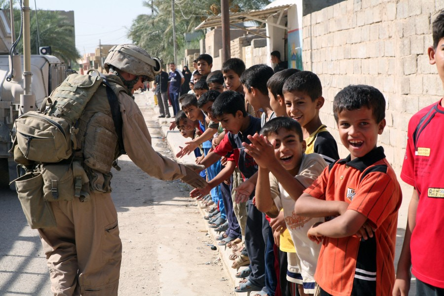 US Navy 070809-M-6412C-028 A Marine attached to Regimental Combat Team (RCT) 6 gives a line of Iraqi children high fives during Operation Alljah
