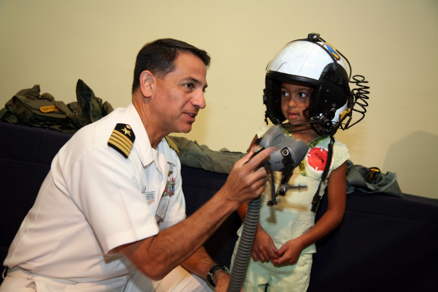 US Navy 070829-N-3271W-002 Capt. Herman Shelanski, commanding officer of USS Harry S. Truman, suits up a young pilot at the St. Louis Science Center