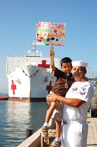 US Navy 080925-N-3570S-028 Electronic's Technician 2nd Class Jose Angel Alcala holds his six-year old son