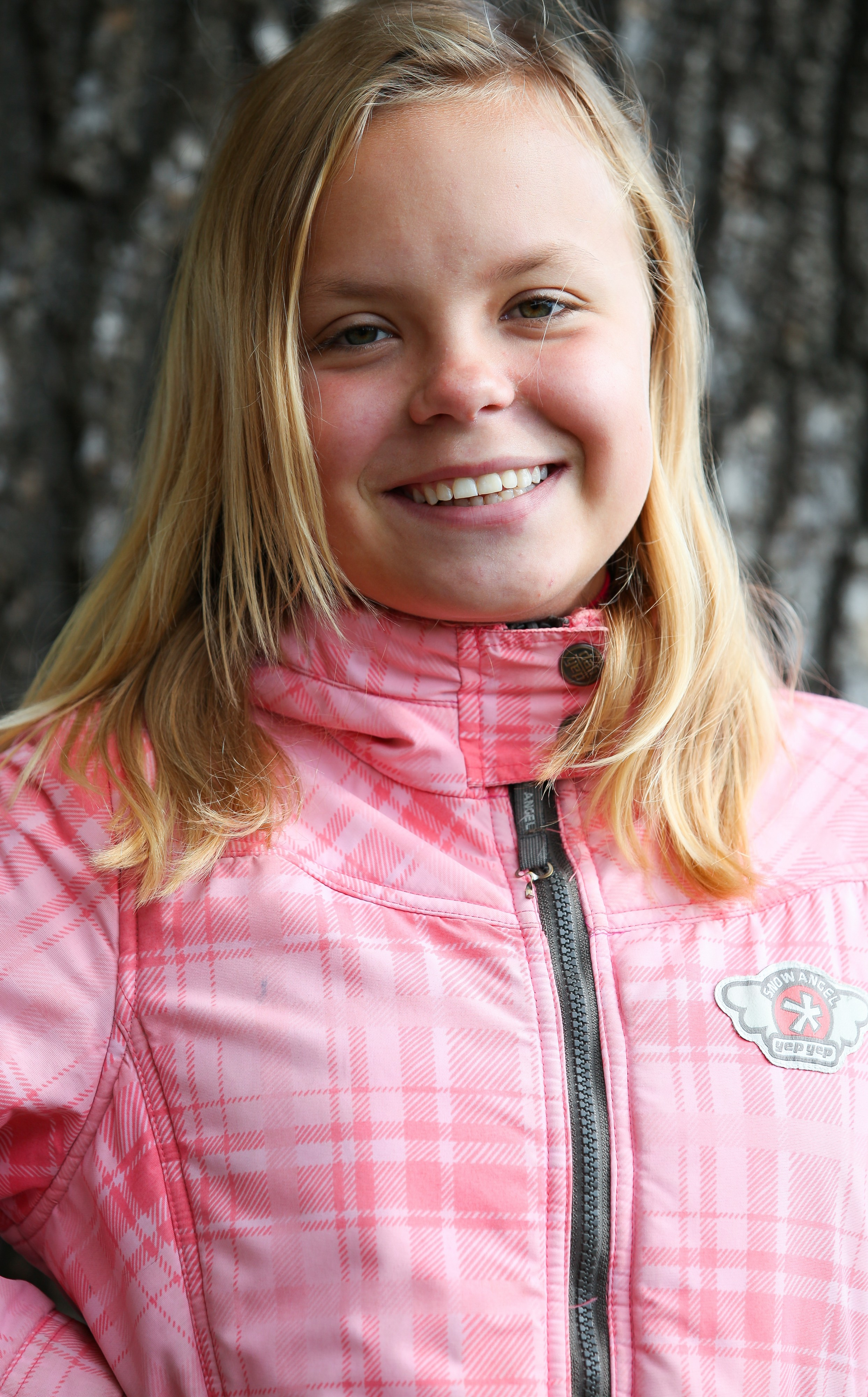 a young smiling blond Catholic girl photographed in September 2013, picture 4/4