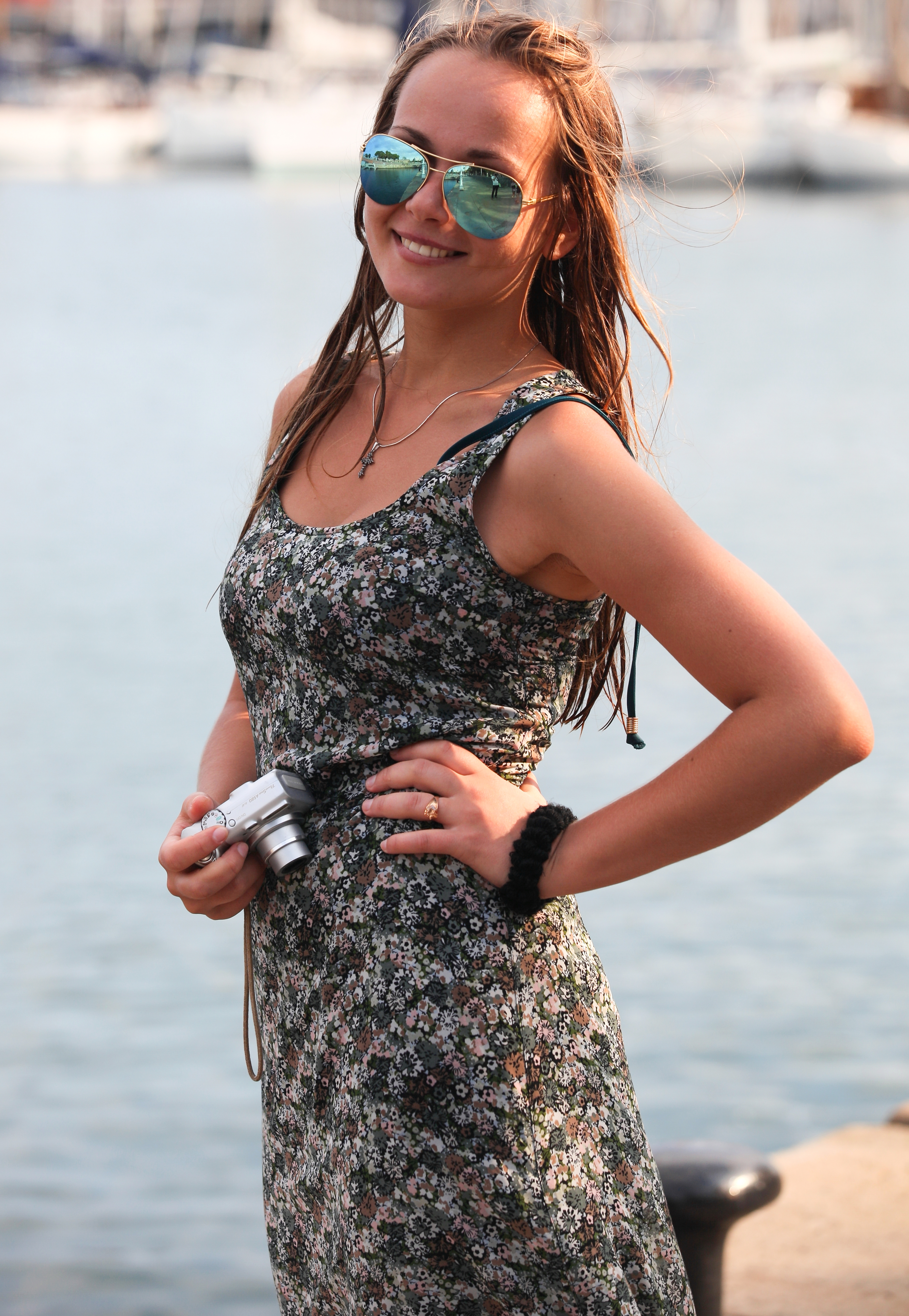 a beautiful girl holding a camera, photographed in Barcelona, Catalonia, Spain in August 2013, portrait 10