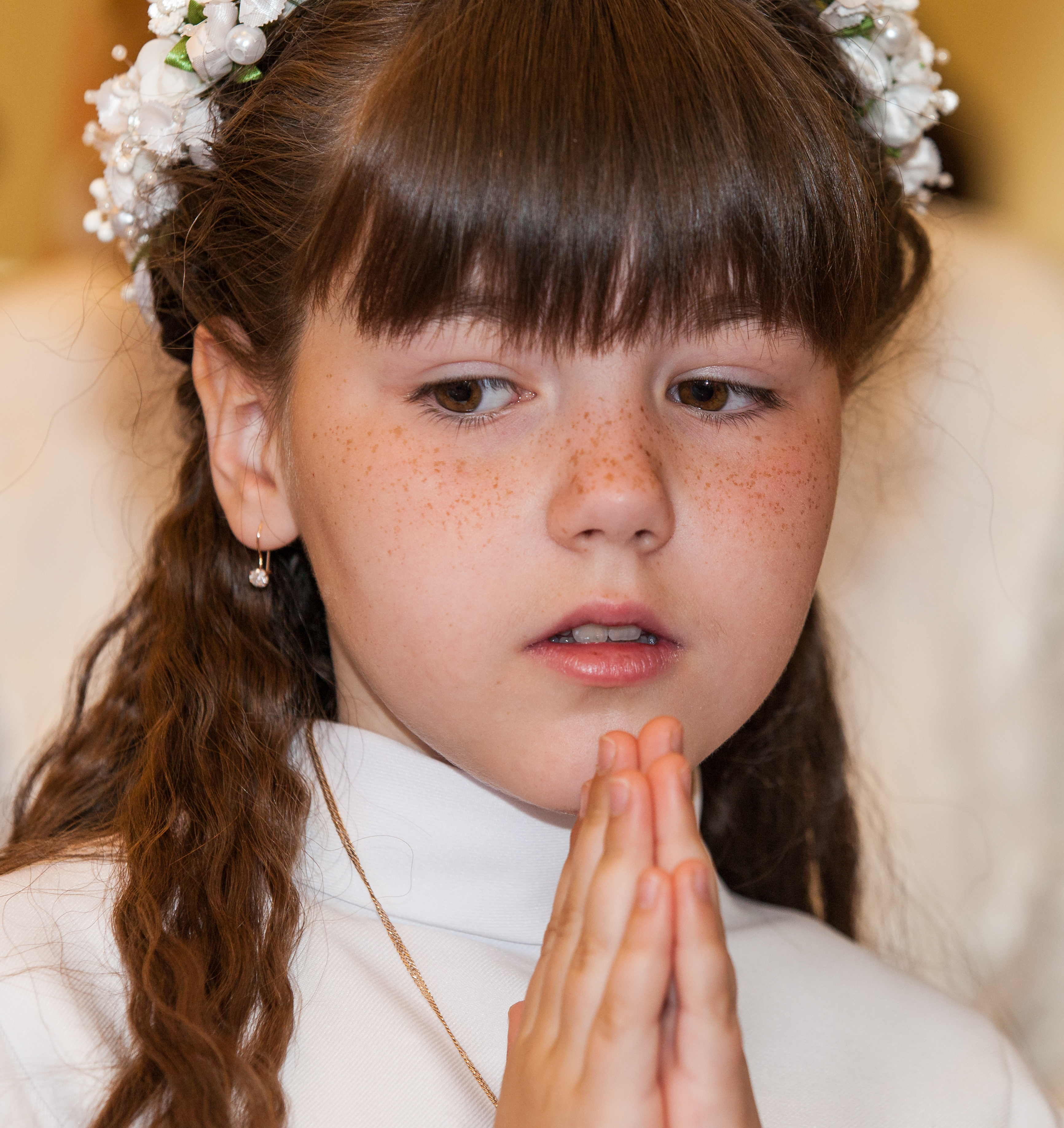 a Catholic child girl on her first Holy Communion Mass in June 2014, picture 2/4