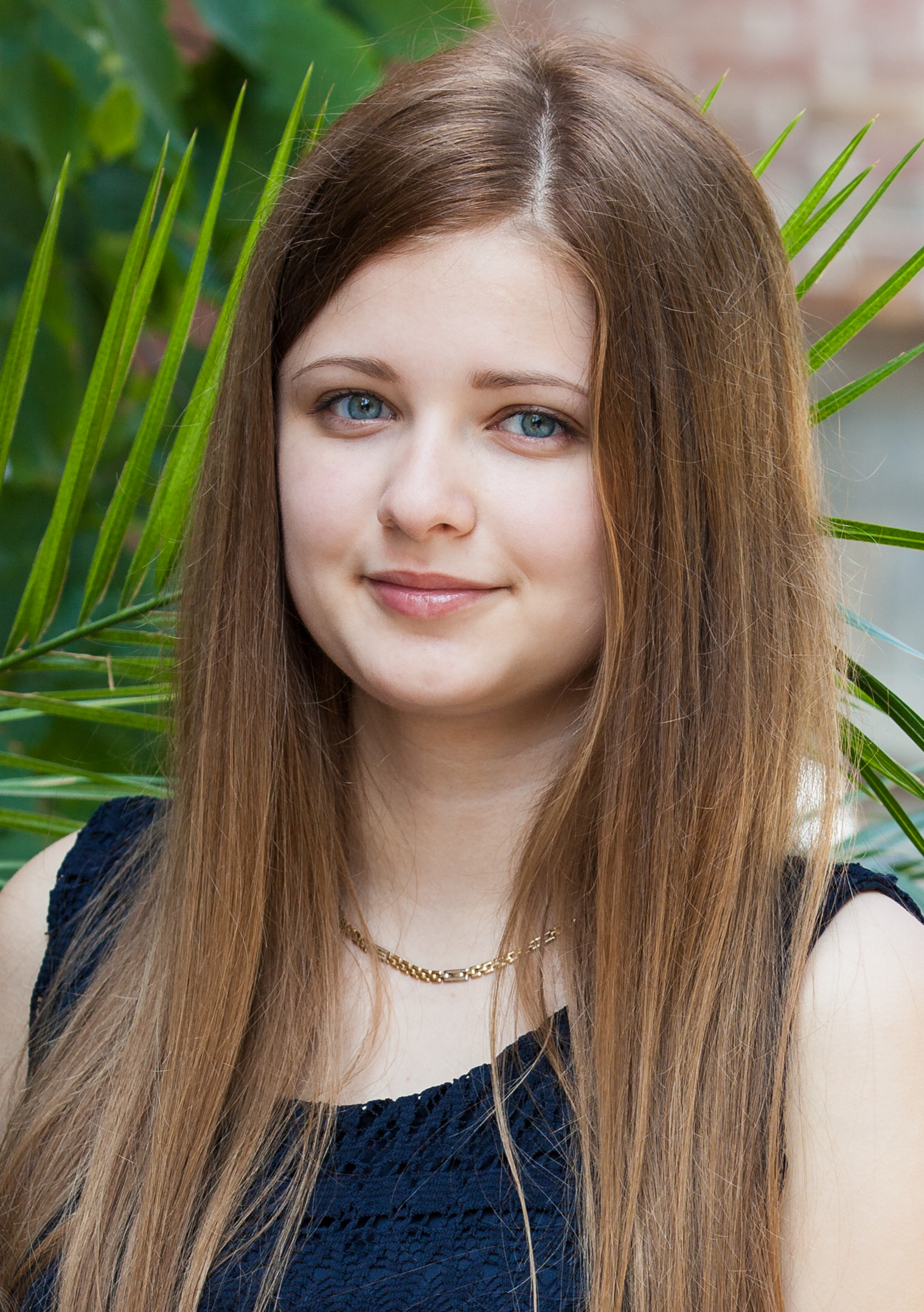 a cute young long-haired girl photographed in June 2014, picture 1/2