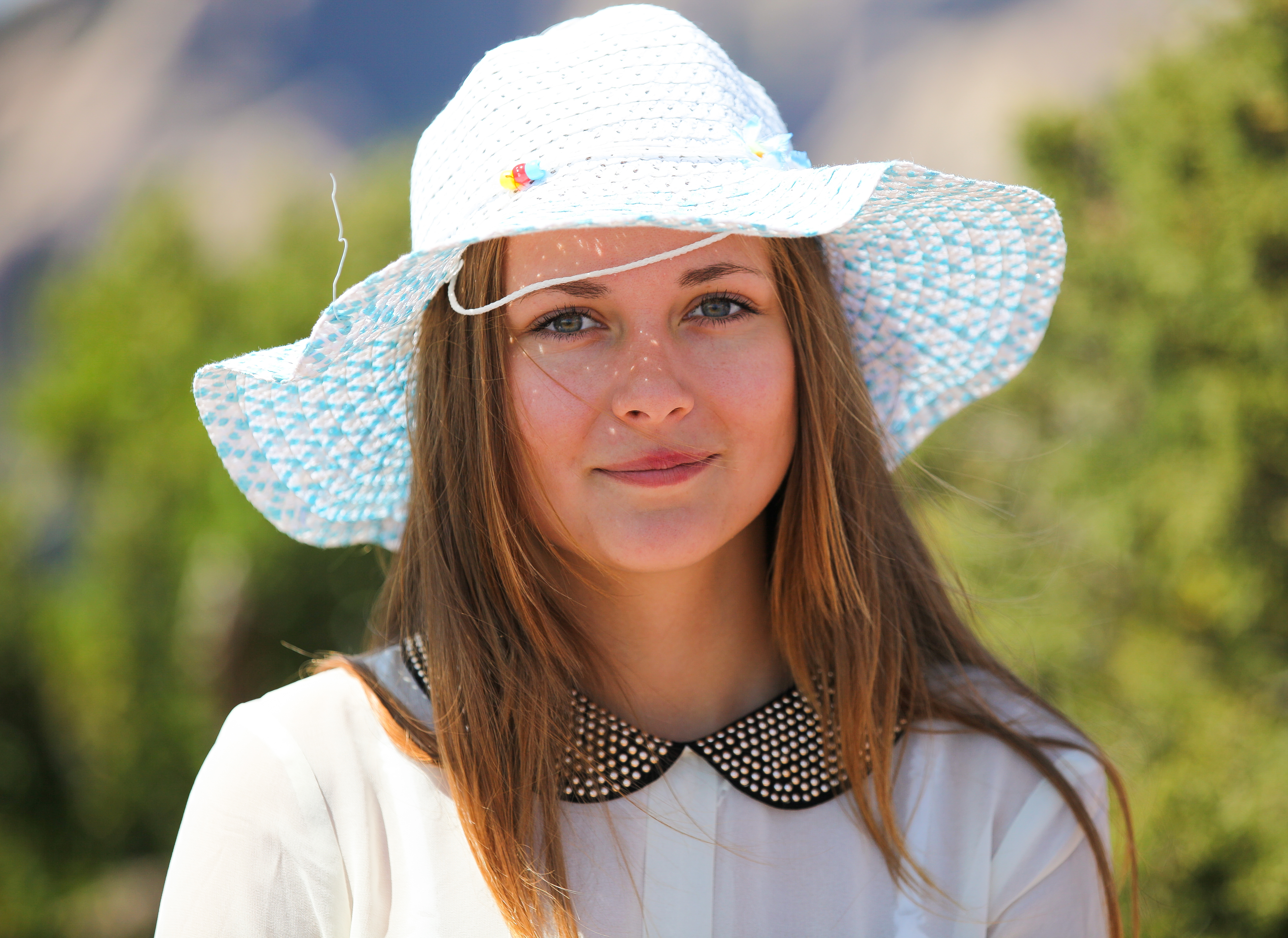 a cute Catholic girl in a hat photographed in August 2013, photo 2