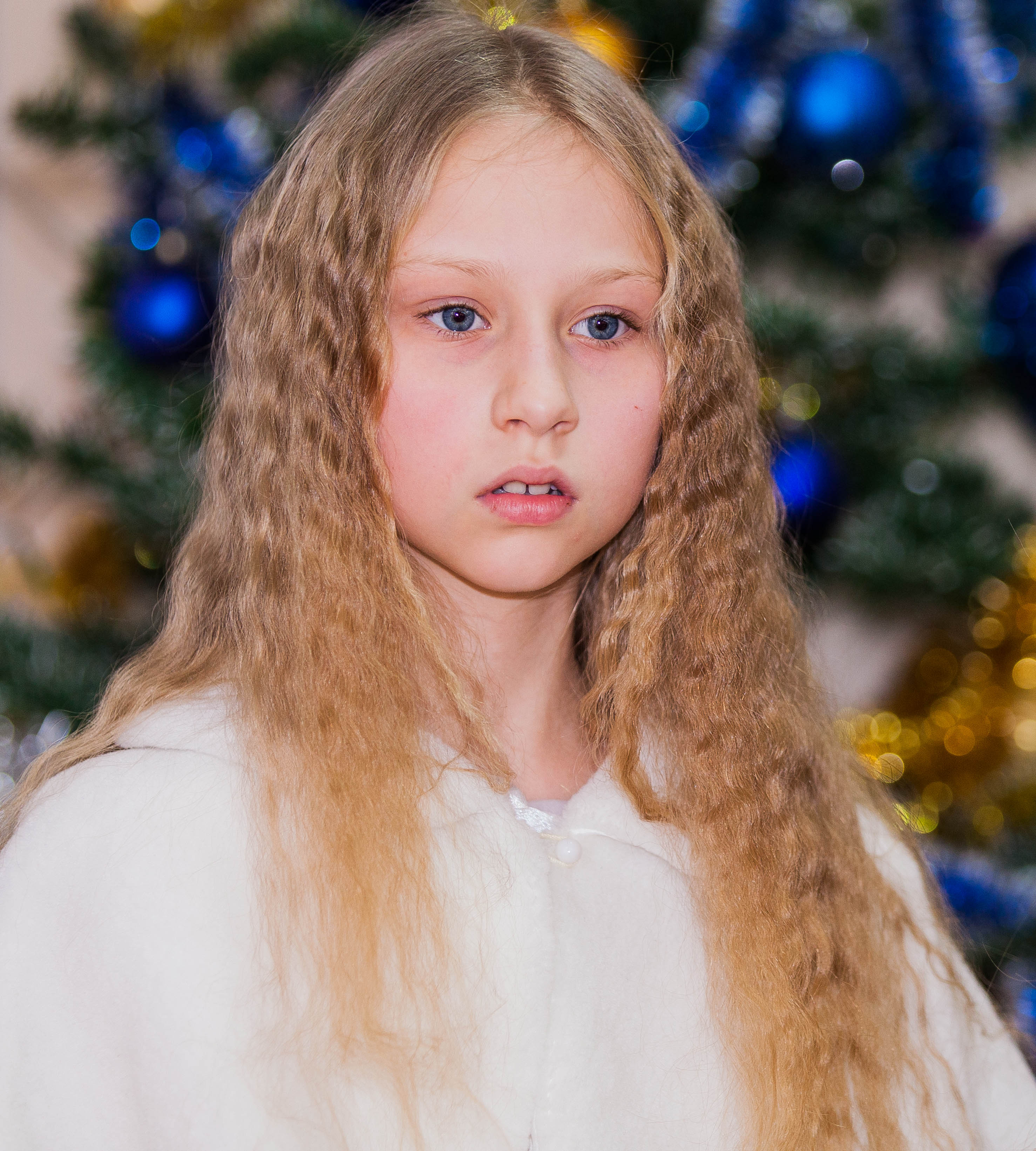 a young blond pretty schoolgirl photographed in December 2013, picture 1/6