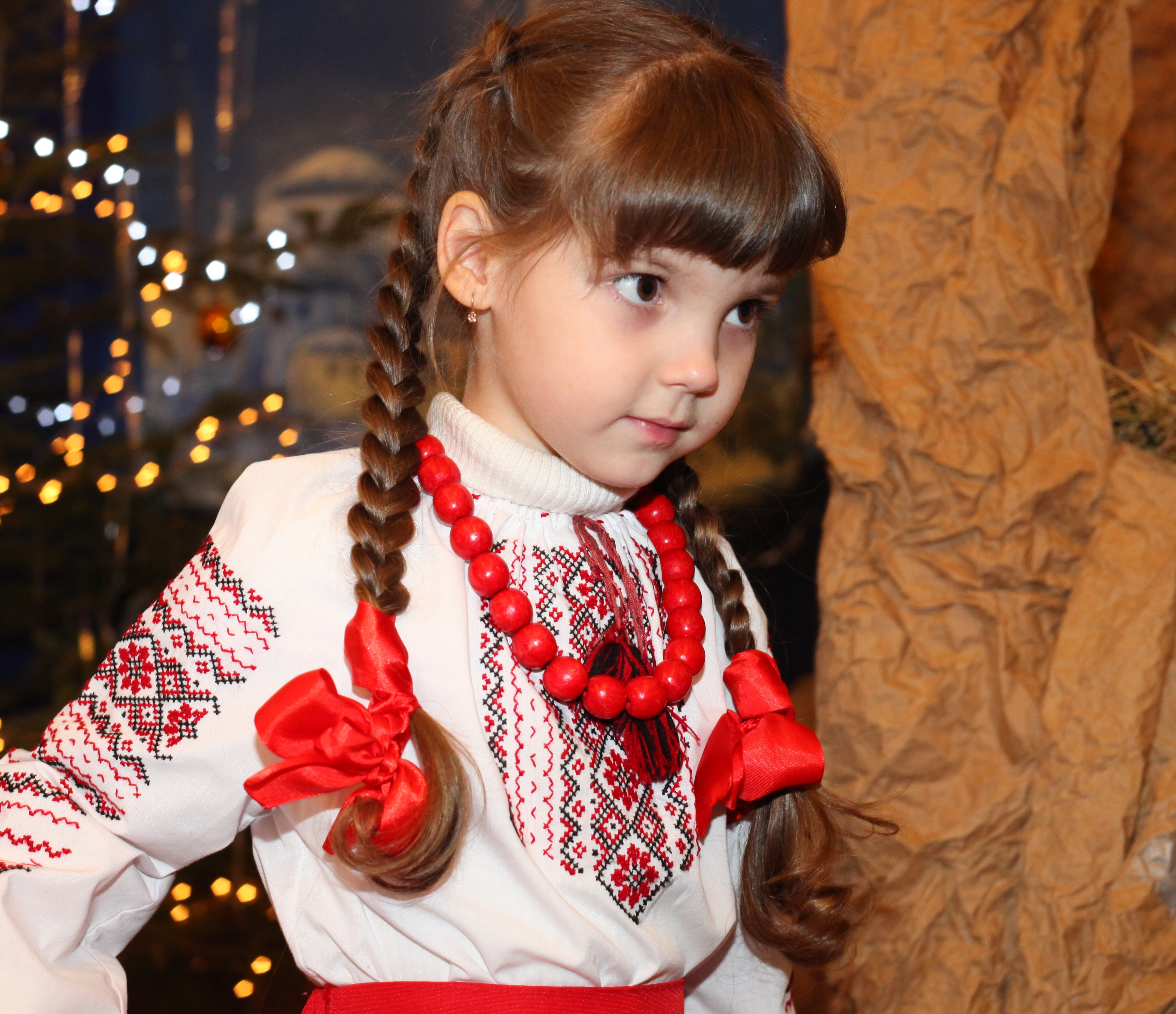 an amazingly beautiful brunette Catholic child girl performing in the Nativity scene, photo 1