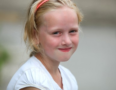 a beautiful young blond charming Catholic girl in a Christian camp in July 2013, picture 3/8