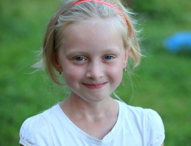 a cute young blond girl (a Catholic Christian) in a Christian camp in July 2013, picture 6/8