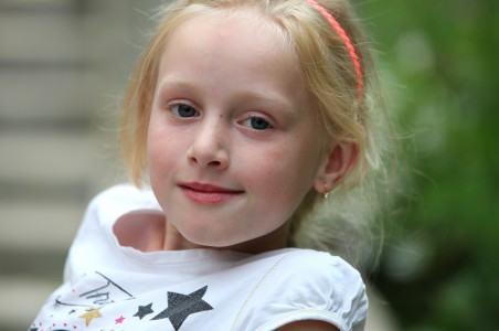 a beautiful young blond girl (a Catholic Christian) in a Christian camp in July 2013, picture 7/8
