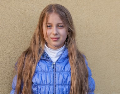 a blond long-haired Roman-Catholic girl photographed in April 2014, portrait 1 out of 11