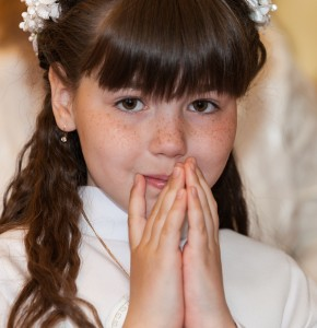 a Catholic child girl on her first Holy Communion Mass in June 2014, picture 1/4
