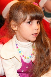 a beautiful Catholic girl at st. Nicholas day celebration in a Catholic kindergarten, photo 9