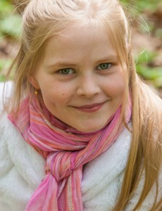 a cute Roman-Catholic blond child girl photographed in April 2014, portrait 19/29