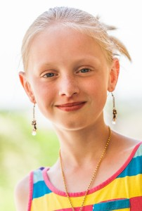 a cute young blond Catholic girl photographed in May 2014, portrait 5/12
