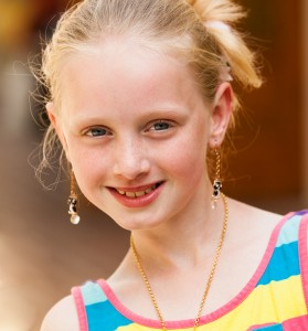a cute young blond Catholic girl photographed in May 2014, portrait 8/12