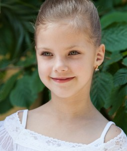 a fair-haired cute child girl photographed in June 2014, picture 1/2