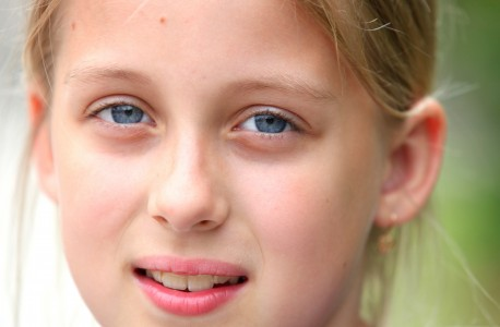 a closeup of a beautiful sweet blond young Roman-Catholic girl in a Christian camp in July 2013, portrait 4/5